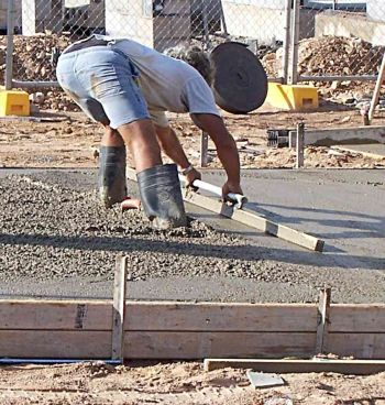 Screeding Wet Concrete