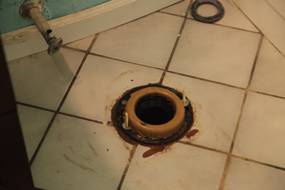 A toilet wax ring mounted in the flange; photo courtesy Kelly Smith